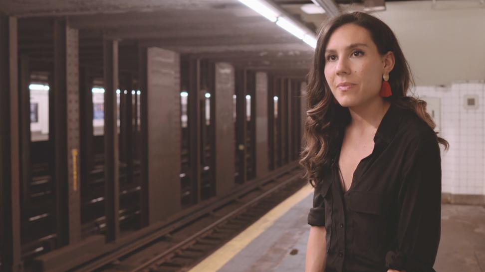 Image of a woman on a New York city subway platform