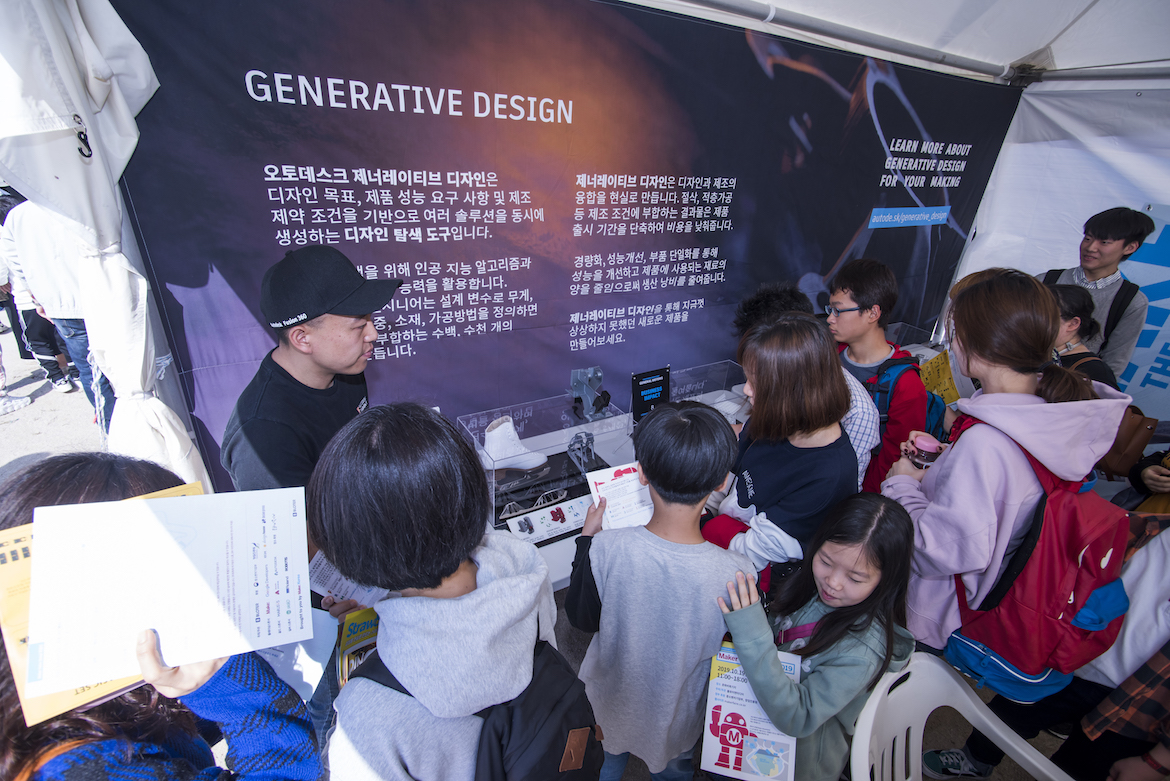 Korean visitors examine a technology display at Maker Faire in Seoul, Korea.