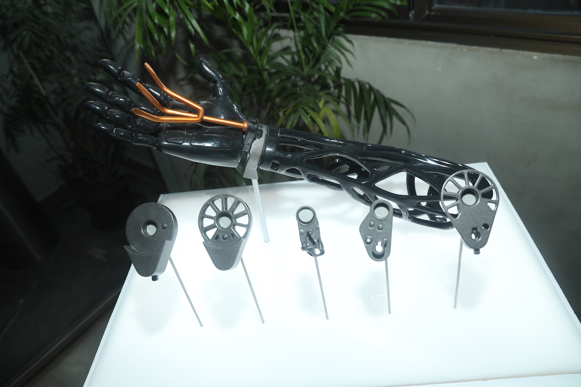 display of a prosthetic arm with different parts that were created with generative design.