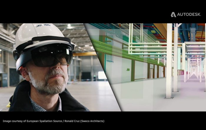 Man in construction hard hat and VR headset works on construction site