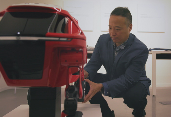 John Suh, Hyundai's founding director of the company's New Horizons Studio, examines components of the Elevate prototype that need to be exceedingly strong and light.