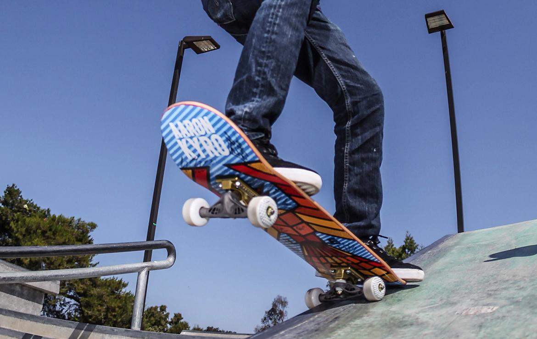 Underside of skateboard showing a 3D-printed, generatively designed skateboard truck