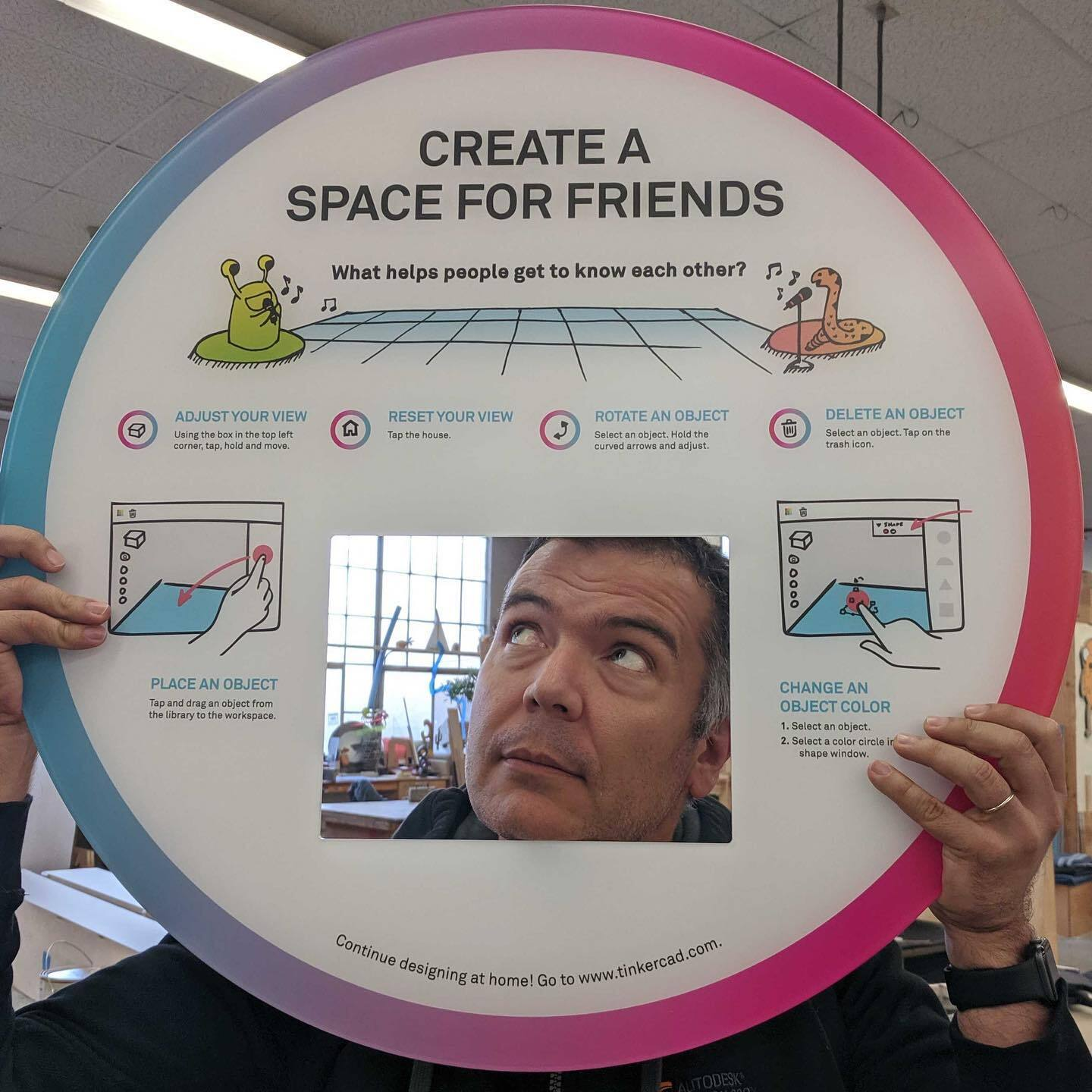"man posing with sign that creates ""Create a space for friends"""