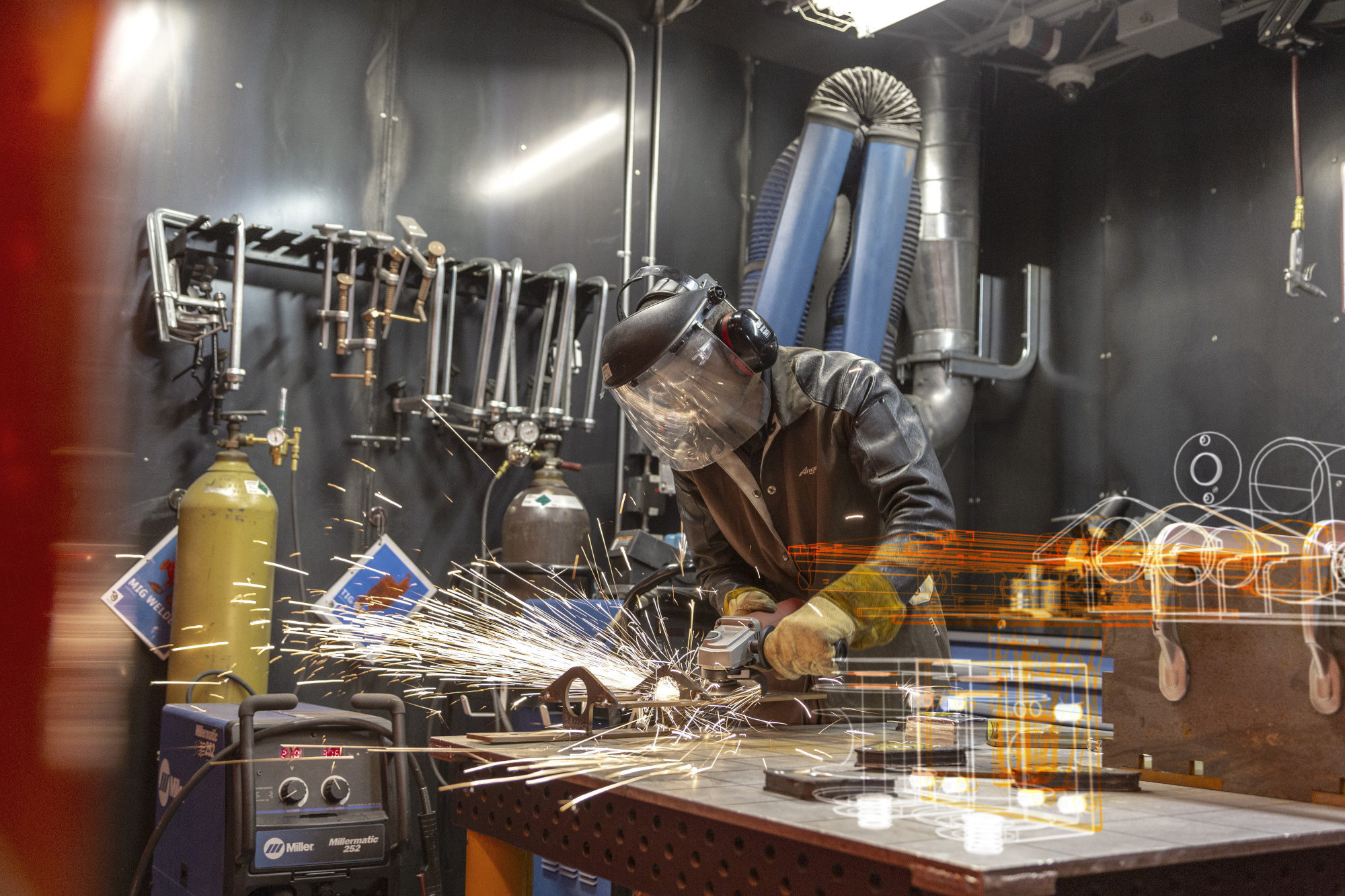 a man welding in the Autodesk Tech Center as part of his residency supported by the Autodesk Foundation
