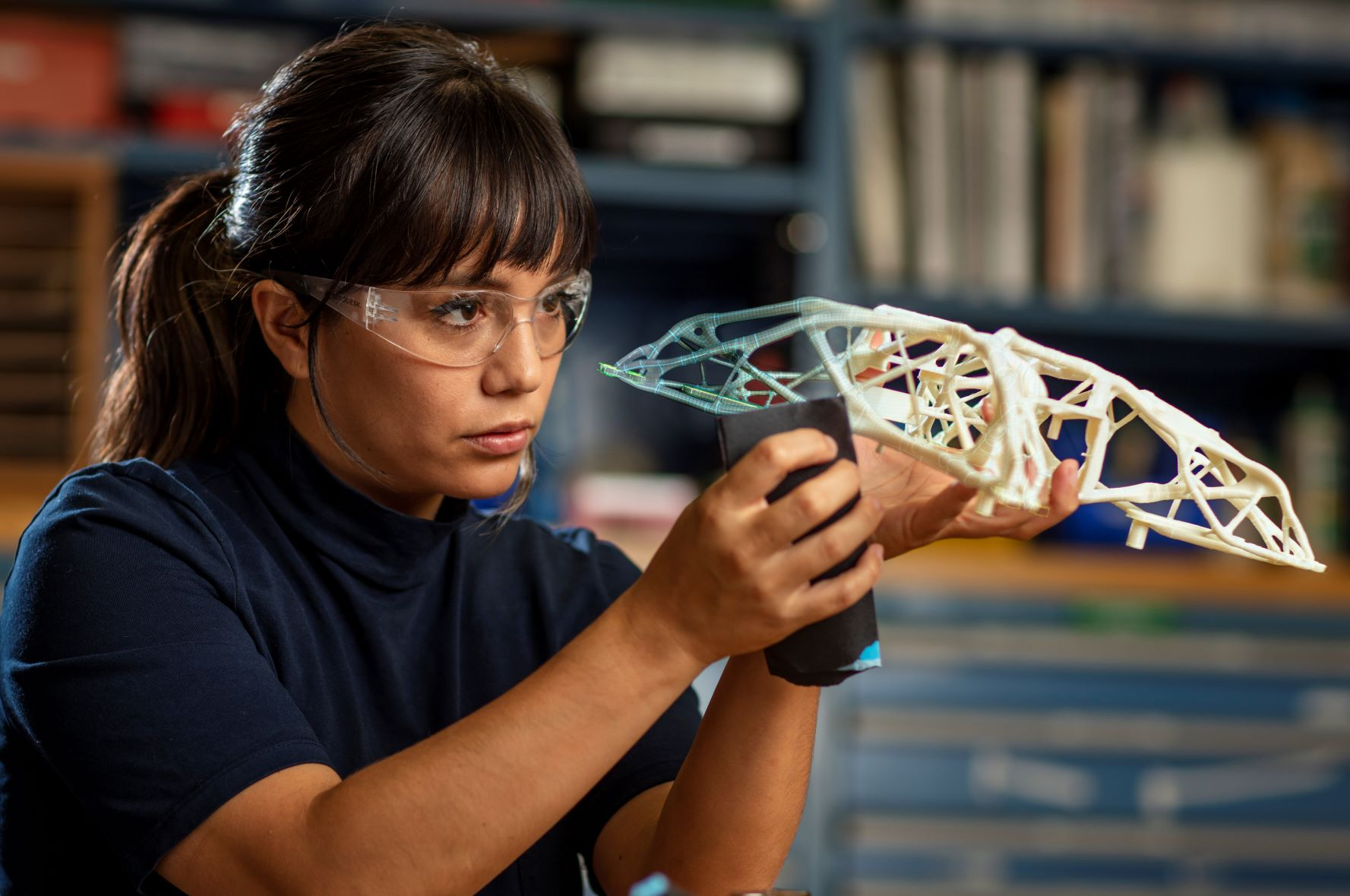 Woman working with a generatively designed part at the Autodesk San Francisco Technology Center.
