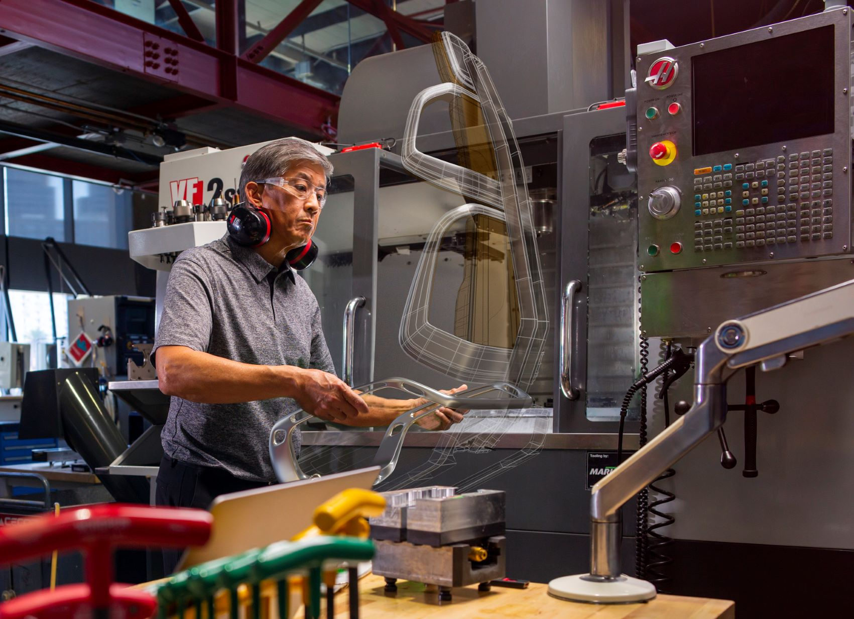 Man working with CNC machinery at the Autodesk San Francisco Technology Center.