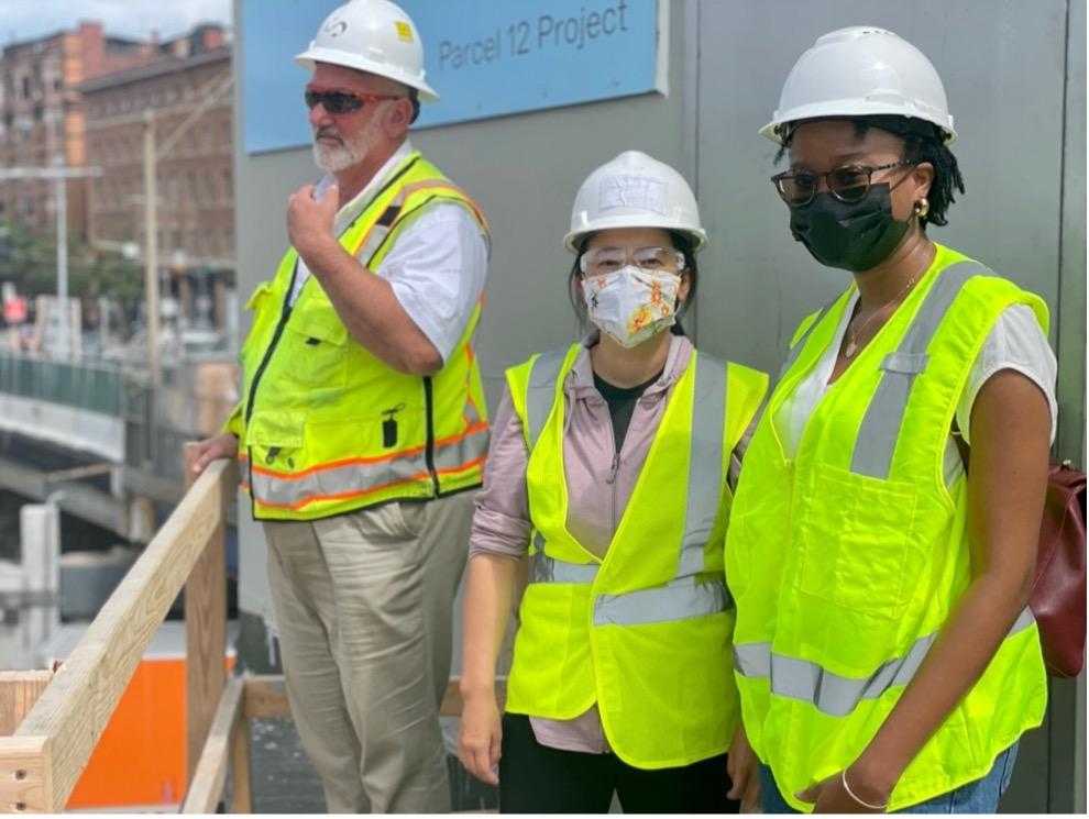 A school teacher takes a tour of Boston's Parcel 12 Project